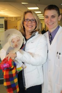 Bobo, his owner and Dr. Coster resized.